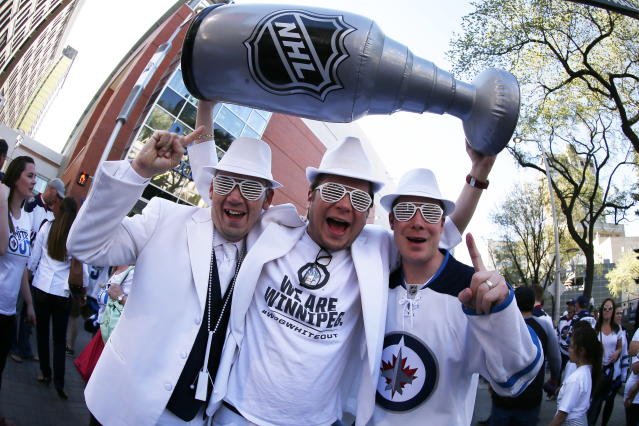 Winnipeg Jets fans Jeff Pinchin, Brandon Klimenko and Justin Danielson, from left, gather before Game 1 of the NHL hockey Western Conference final between the Jets and the Vegas Golden Knights on Saturday, May 12, 2108, in Winnipeg, Manitoba. (John Woods/The Canadian Press via AP)
