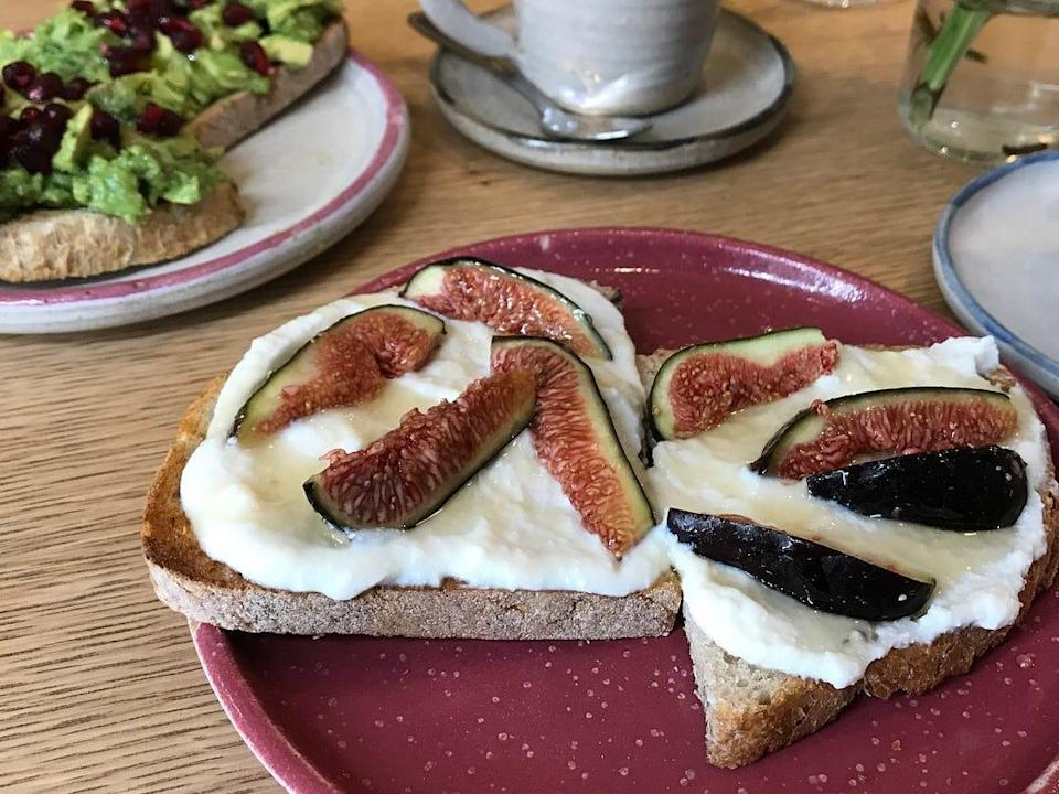 Two slices of toast with ricotta and figs