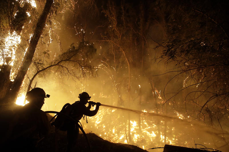 Firefighters battle the Maria Fire Friday, Nov. 1, 2019, in Somis, Calif. (AP Photo/Marcio Jose Sanchez)