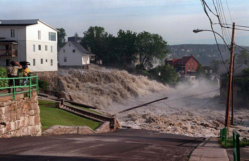 <p>On July 22, 1996, floodwaters can be seen surging into the streets of Chicoutimi, Que., forcing more than 10,000 people to evacuate the area. Photo from The Canadian Press. </p>