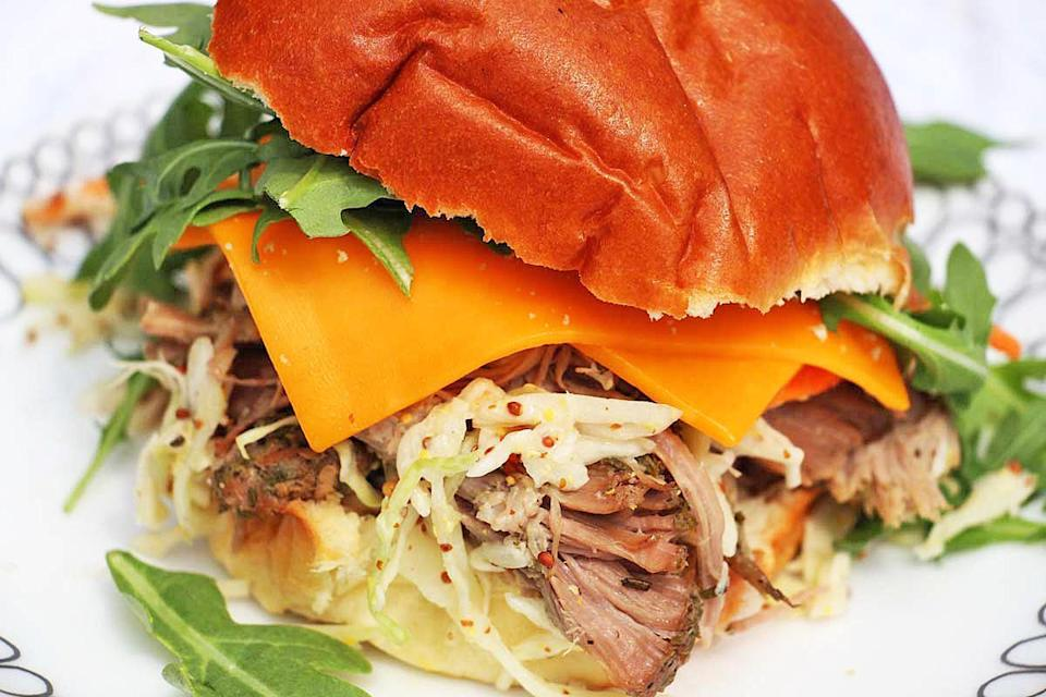 """<p>This pulled pork recipe is <a href=""""https://www.thedailymeal.com/sandwich-recipes-better-than-mom-made-gallery?referrer=yahoo&category=beauty_food&include_utm=1&utm_medium=referral&utm_source=yahoo&utm_campaign=feed"""" rel=""""nofollow noopener"""" target=""""_blank"""" data-ylk=""""slk:even tastier than what mom used to make."""" class=""""link rapid-noclick-resp"""">even tastier than what mom used to make.</a> While you wait in line to cast your vote at the polls, the meat cooks low and slow in a slow cooker until it's tender and flavorful.</p> <p><a href=""""https://www.thedailymeal.com/pulled-pork-sandwich?referrer=yahoo&category=beauty_food&include_utm=1&utm_medium=referral&utm_source=yahoo&utm_campaign=feed"""" rel=""""nofollow noopener"""" target=""""_blank"""" data-ylk=""""slk:For the Pulled Pork Sandwiches recipe, click here."""" class=""""link rapid-noclick-resp"""">For the Pulled Pork Sandwiches recipe, click here.</a></p>"""
