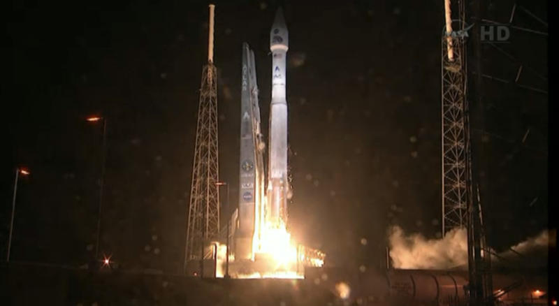 This framegrab image provided by NASA-TV shows the Atlas V first stage and Centaur upper stage as it lifts off the launch pad at Cape Canaveral Air Force Station, Florida early Thursday Aug. 30, 2012. The Radiation Belt Storm Probes mission is a pair of identical spacecraft loaded with scienitific instruments which will follow each other through the Van Allen radiation belts around the Earth to gain unprecedented knowledge about the region. (AP Photo/NASA)