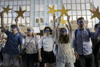 "Protesters hold EU stars and keep their eyes closed in front of the German Embassy in Sofia, Bulgaria, Wednesday, Aug. 12, 2020. Several hundred anti-government protesters gathered in front of Germany's embassy, calling on Berlin and Brussels to ""open their eyes"" to widespread corruption in Bulgaria. During the peaceful protest, dubbed ""Eyes Wide Shut,"" organizers complained that the European Union has willfully ignored the state of affairs in its poorest member state. (AP Photo/Valentina Petrova)"