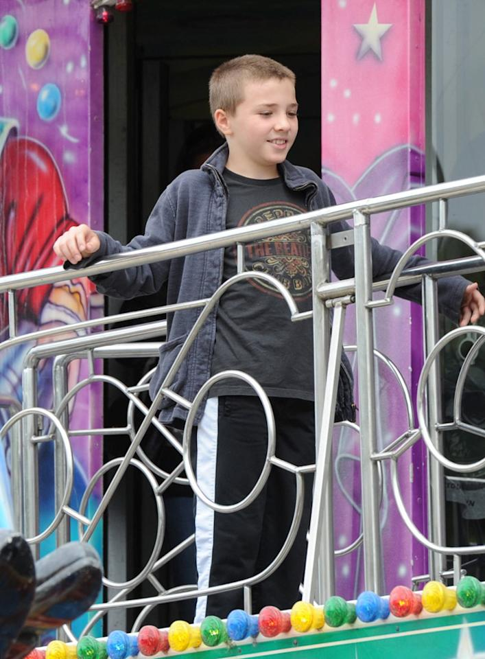 """Rocco, the singer's 9-year-old son with Guy Ritchie, and his three siblings spent the afternoon at an amusement park at the Jardin des Tuileries in Paris. Looks like he's a Beatles fan! A/<a href=""""http://www.x17online.com"""" target=""""new"""">X17 Online</a> - August 1, 2010"""