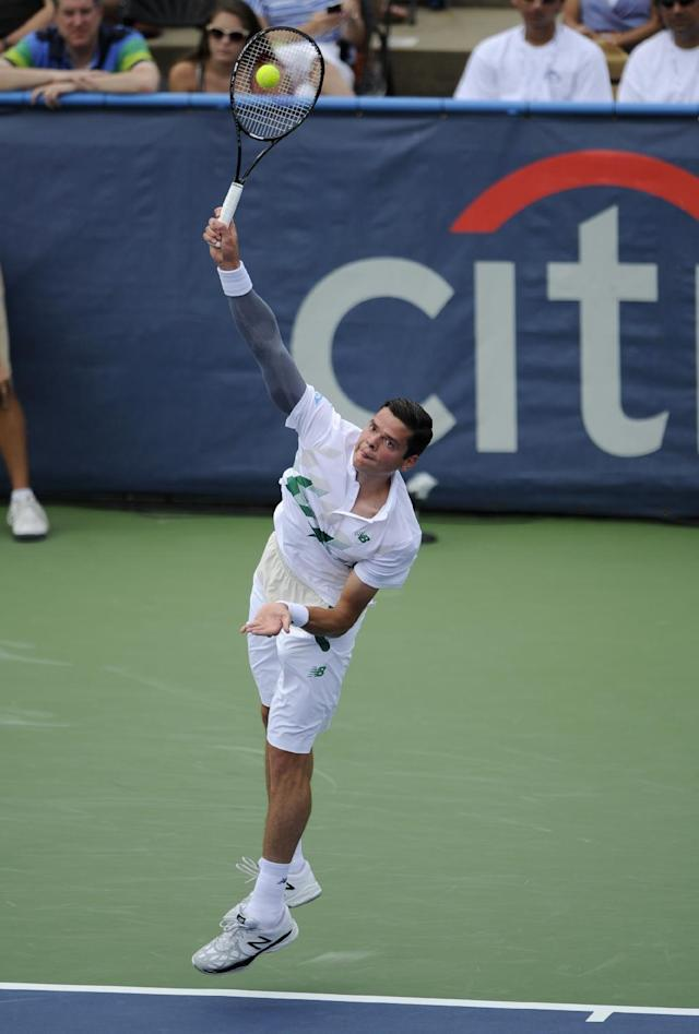 Milos Raonic, of Canada, serves to Donald Young during a match at the Citi Open tennis tournament, Saturday, Aug. 2, 2014, in Washington. (AP Photo/Nick Wass)
