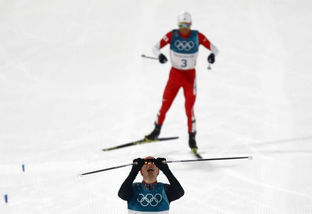 Nordic Combined Events – Pyeongchang 2018 Winter Olympics – Men's Individual 10km Final – Alpensia Cross-Country Skiing Centre - Pyeongchang, South Korea – February 14, 2018 - Eric Frenzel of Germany celebrates his win ahead of Akito Watabe of Japan. REUTERS/Kai Pfaffenbach
