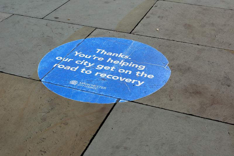 MANCHESTER, ENGLAND - OCTOBER 14: A social distancing marker is seen on the floor in Manchester City Centre on October 14, 2020 in Manchester, England. Under a new three-tier system, English cities will be subject to lockdown measures corresponding with the severity of covid-19 outbreaks in their areas. (Photo by Charlotte Tattersall/Getty Images)
