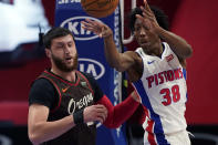 Detroit Pistons guard Saben Lee (38) passes as Portland Trail Blazers center Jusuf Nurkic (27) defends during the first half of an NBA basketball game, Wednesday, March 31, 2021, in Detroit. (AP Photo/Carlos Osorio)