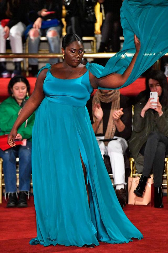 <p>Curvy actress and star in <em>Orange is the New Black</em> dazzles in a vibrant blue gown at the Christian Siriano FW18 show. (Photo: Getty) </p>