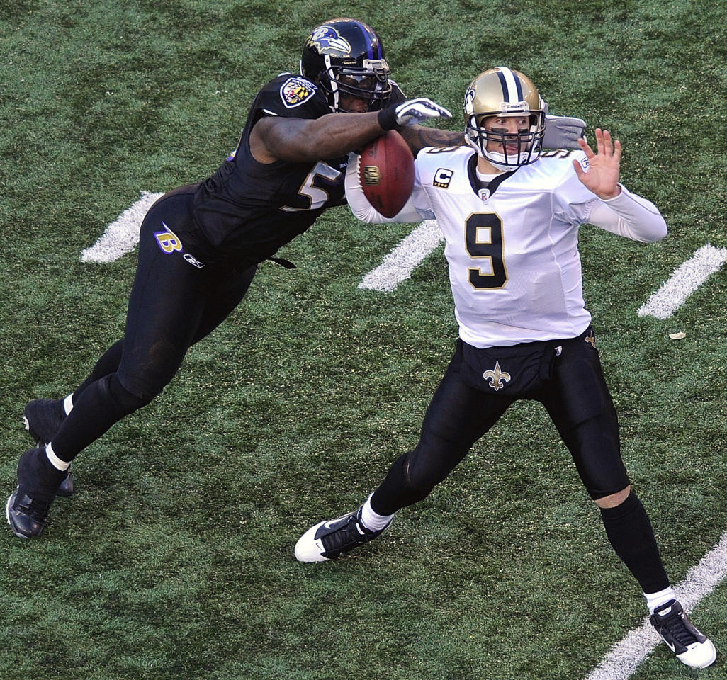 Baltimore Ravens linebacker Terrell Suggs, left, strips the ball from New Orleans Saints quarterback Drew Brees during the second half of an NFL football game in Baltimore, Sunday, Dec. 19, 2010.