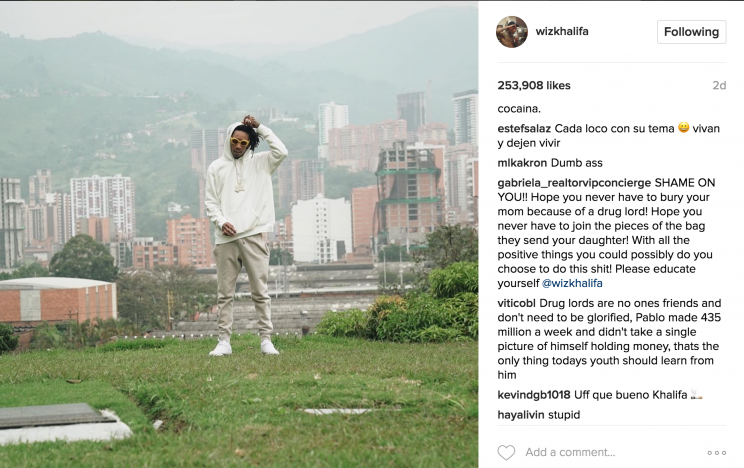 Screenshot of Wiz Khalifa's Instagram picture of him smoking near Escobar's grave.