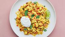 """A vegan weeknight dinner of fluffy, textured cauliflower with warm spices from chef <a href=""""http://www.iamsophiaroe.com/"""" rel=""""nofollow noopener"""" target=""""_blank"""" data-ylk=""""slk:Sophia Roe"""" class=""""link rapid-noclick-resp""""><strong>Sophia Roe</strong></a><strong>.</strong> Doctor up your cauliflower rice with toasted pine nuts or almonds, dates or dried currants, lots of fresh herbs, unsweetened coconut flakes, or chopped fresh chile. Strict paleo? Skip the Greek yogurt when serving. <a href=""""https://www.bonappetit.com/recipe/all-dressed-up-cauliflower-rice?mbid=synd_yahoo_rss"""" rel=""""nofollow noopener"""" target=""""_blank"""" data-ylk=""""slk:See recipe."""" class=""""link rapid-noclick-resp"""">See recipe.</a>"""
