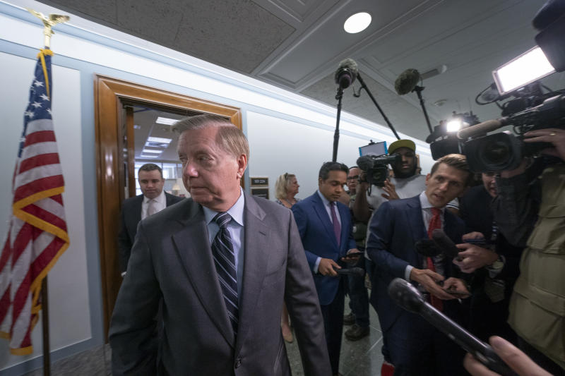 Sen. Lindsey Graham, R-S.C., chairman of the Senate Judiciary Committee, finishes his response to reporters about his earlier advice to Donald Trump Jr. on being subpoenaed by the Senate Intelligence Committee, on Capitol Hill in Washington, Tuesday, May 14, 2019. (AP Photo/J. Scott Applewhite)