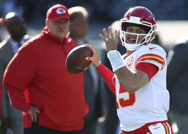 FILE - In this Dec. 2, 2018, file photo, Kansas City Chiefs coach Andy Reid, left, watches quarterback Patrick Mahomes (15) warm up for the team's NFL football game against the Oakland Raiders in Oakland, Calif. The Indianapolis Colts play the Chiefs in a divisional playoff game on Saturday, Jan. 12, 2019.(AP Photo/Ben Margot, File)