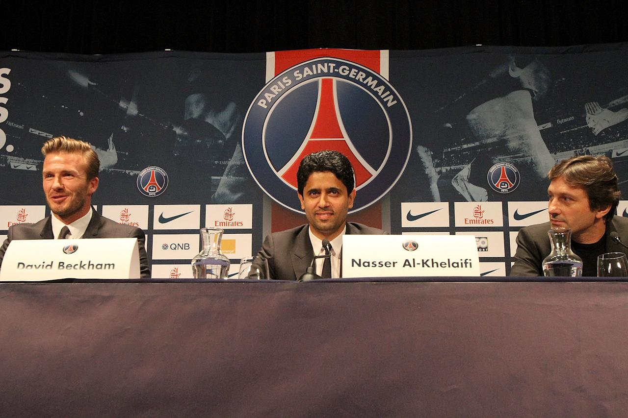 PARIS, FRANCE - JANUARY 31:  International soccer player David Beckham, Nasser Al-Khelaifi and Leonardo attend the press conference for his PSG signing at Parc des Princes on January 31, 2013 in Paris, France.  (Photo by Marc Piasecki/Getty Images)
