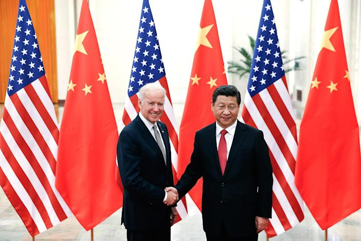 Image: Chinese President Xi Jinping with Joe Biden inside the Great Hall of the People in Beijing (Lintao Zhang / AFP - Getty Images file)