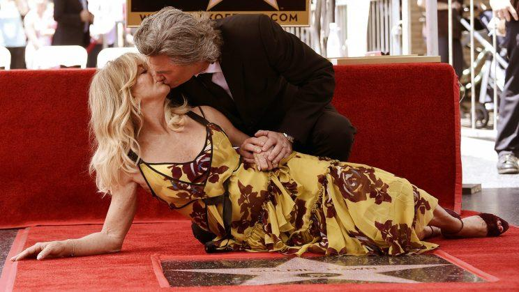 Stars... Russell and Hawn unveiled their place on the Hollywood Walk of Fame - Credit: PA