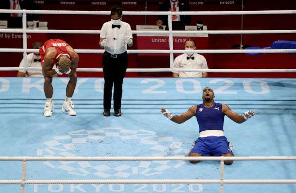 PHOTO:  Arlen Lopez Cardona of Cuba and Benjamin Whittaker of Britain react after their fight on Aug. 4, 2021, in Tokyo, Japan.  (Carl Recine/Reuters)