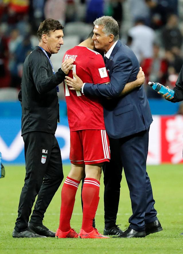 Soccer Football - World Cup - Group B - Iran vs Spain - Kazan Arena, Kazan, Russia - June 20, 2018 Iran's Mehdi Taremi hugs coach Carlos Queiroz after the match REUTERS/Toru Hanai