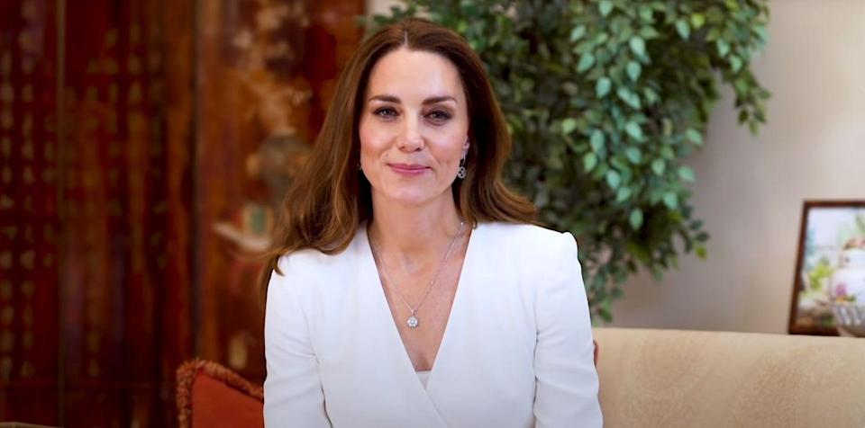 """<p>Kate chose a white Alexander McQueen blouse and matching skirt to record <a href=""""https://www.youtube.com/watch?v=IZqLm6MeRAg"""" rel=""""nofollow noopener"""" target=""""_blank"""" data-ylk=""""slk:a video for the Nursing Now"""" class=""""link rapid-noclick-resp"""">a video for the Nursing Now</a> charitable campaign. The Duchess also wore a silver <a href=""""https://www.asprey.com/us/daisy-heritage-pendant-diamond.html"""" rel=""""nofollow noopener"""" target=""""_blank"""" data-ylk=""""slk:pendant necklace by Asprey London"""" class=""""link rapid-noclick-resp"""">pendant necklace by Asprey London</a>. </p>"""