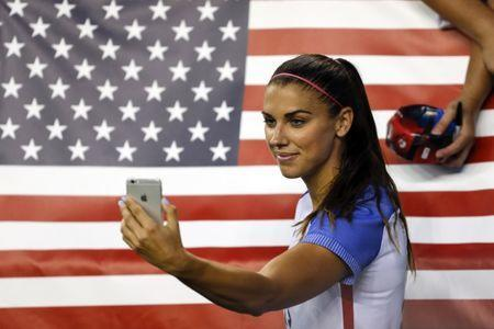 Jul 27, 2017; Seattle, WA, USA; USA forward Alex Morgan (13) poses for a selfie following a 1-0 loss against Australia at Century Link Field. Mandatory Credit: Joe Nicholson-USA TODAY Sports