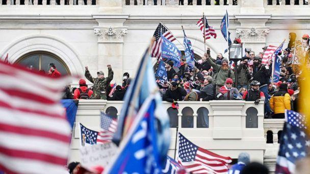 PHOTO: Supporters of President Donald Trump take over balconies and inauguration scaffolding at the United States Capitol, Jan. 06, 2021. (The Washington Post via Getty Images, FILE)