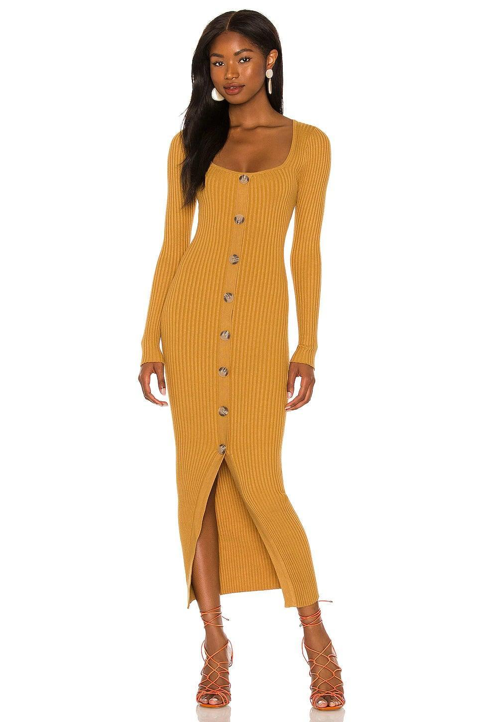 <p>We're in love with the gorgeous yellow shade of this <span>MinkPink Phrada Button Midi Dress in Gold</span> ($109). It's a great way to bring in brighter colors yet compliment the fall vibe. </p>