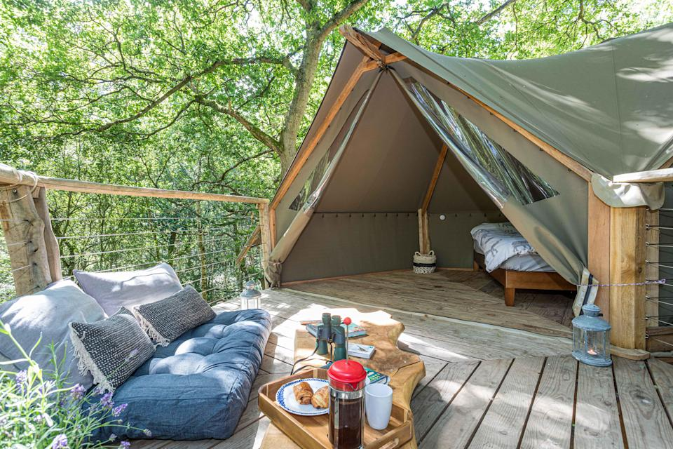 """<strong><a href=""""http://airbnb.pvxt.net/Jrr6Or"""" rel=""""nofollow noopener"""" target=""""_blank"""" data-ylk=""""slk:Undercover Woodland Treehouse, West Sussex"""" class=""""link rapid-noclick-resp"""">Undercover Woodland Treehouse, West Sussex </a></strong><br><br>Located in a private wood, this pretty treehouse has an eco-friendly compost toilet and open-air hot shower. You can cook over an open fire, but it's only a 10-minute walk from a local pub if you're not in the mood. <br><br><em>From £80 per night</em>"""