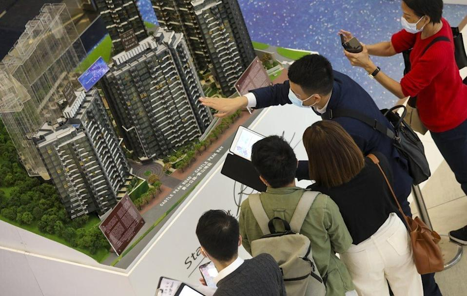 Property buyers viewing the Starfront Royale project in Tuen Mun, at the Tsim Sha Tsui sales office of Hong Kong Ferry and Empire Group on November 1, 2020. Photo: K.Y. Cheng