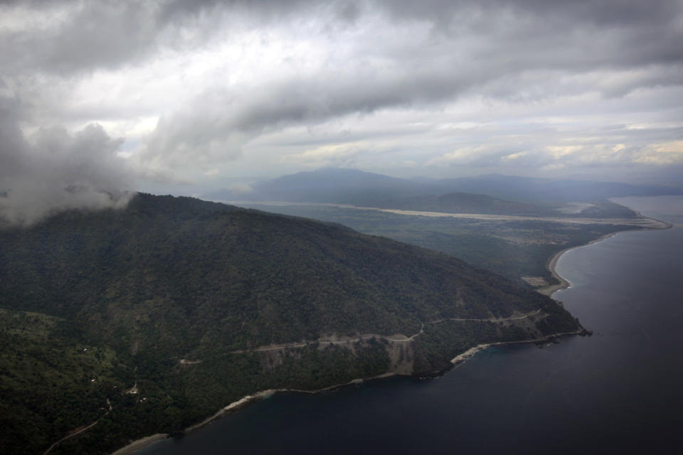 This Monday, July 5, 2010 aerial photo shows Oecussi, East Timor. East Timor was under Portuguese colonial rule until 1975 and then, almost immediately, was invaded by neighboring Indonesia. That sparked a bloody, 24-year independence struggle that left an estimated 200,000 people dead _ a quarter of the population _ through fighting, famine and starvation. (AP Photo/Wong Maye-E)