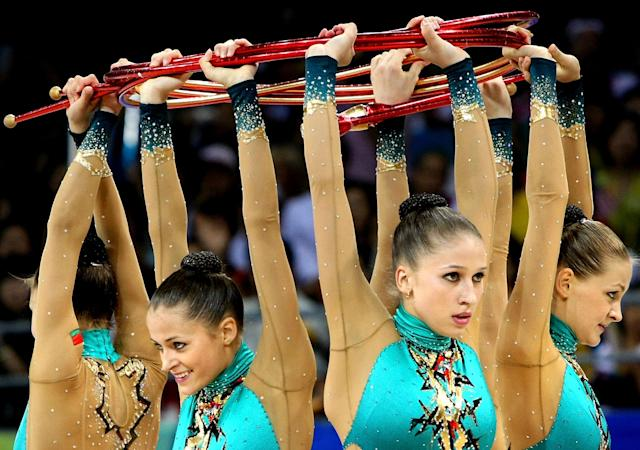 BEIJING - AUGUST 24: The Belarusian team perform in the 3 Hoops and 2 Clubs rotation in the Group All-Around Final held at the Beijing University of Technology Gymnasium during Day 16 of the Beijing 2008 Olympic Games on August 24, 2008 in Beijing, China. (Photo by Nick Laham/Getty Images)