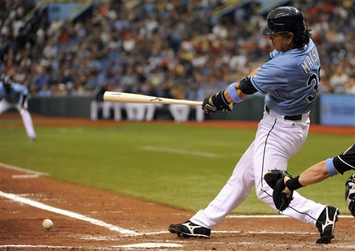 Tampa Bay Rays' Hideki Matsui grounds into the double play with two men on to end the fifth inning of an interleague baseball game against the Miami Marlins, Sunday, June 17, 2012, in St. Petersburg, Fla. (AP Photo/Brian Blanco)