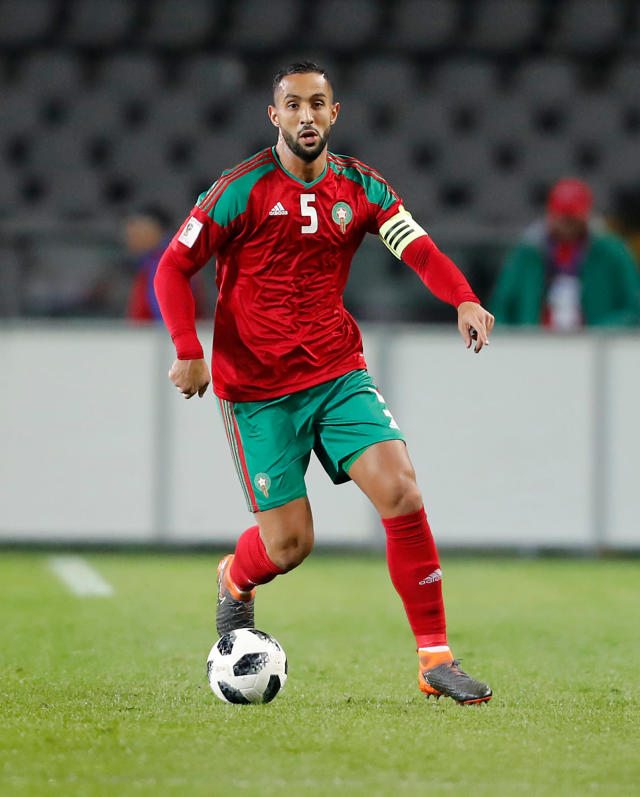 In this photo taken on Thursday, March 22, 2018, Morocco's Medhi Benatia controls the ball during a friendly soccer match between Serbia and Morocco in Turin, Italy. (AP Photo/Antonio Calanni)