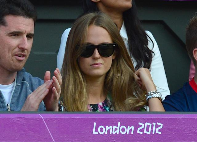 The girlfriend of Great Britain's Andy Murray, Kim Sears, watches as he plays the men's singles gold medal match of the London 2012 Olympic Games against Switzerland's Roger Federer, at the All England Tennis Club in Wimbledon, southwest London, on August 5, 2012. AFP PHOTO / LUIS ACOSTALUIS ACOSTA/AFP/GettyImages
