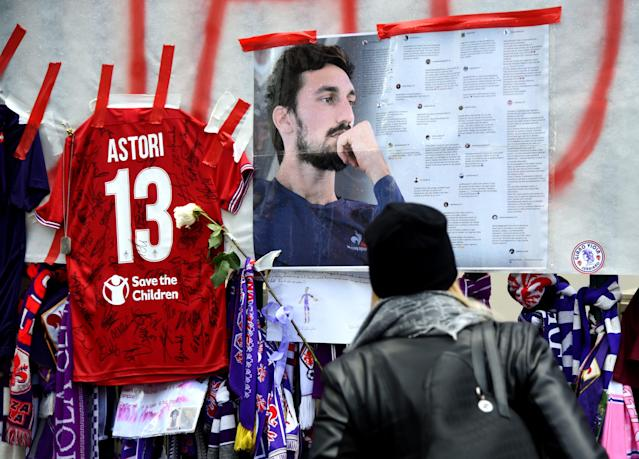 <p>Football fans hang scarves and tributes to late Fiorentina football team captain Davide Astori on the fence of the team stadium on March 7, 2018 in Florence. Italian footballer Davide Astori likely died from a cardiac arrest linked to the slowing of his heart rate following the initial results of his autopsy. Fiorentina and Astori's former club Cagliari announced they will retire his number 13 shirt in honour of the 31-year-old Italy international, who was found dead in his hotel room on Sunday ahead of a Serie A match at Udinese. / AFP PHOTO / Filippo MONTEFORTE (Photo credit should read FILIPPO MONTEFORTE/AFP/Getty Images) </p>