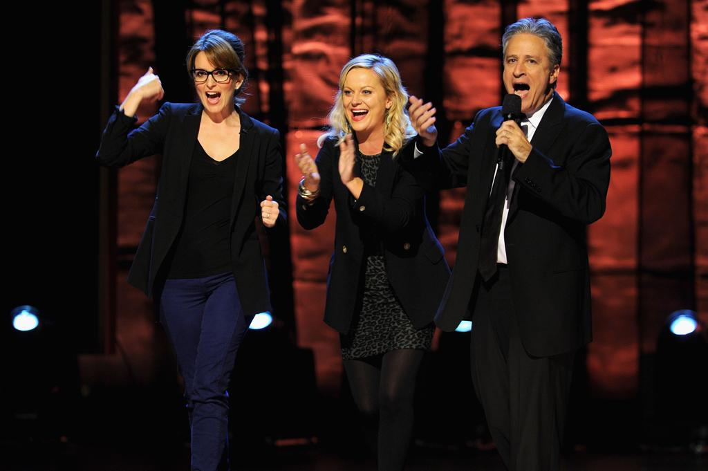 NEW YORK, NY - OCTOBER 13:  (L-R) Tina Fey, Amy Poehler and Jon Stewart speak onstage at Comedy Central's night of too many stars: America comes together for autism programs at The Beacon Theatre on October 13, 2012 in New York City.  (Photo by Dimitrios Kambouris/Getty Images)