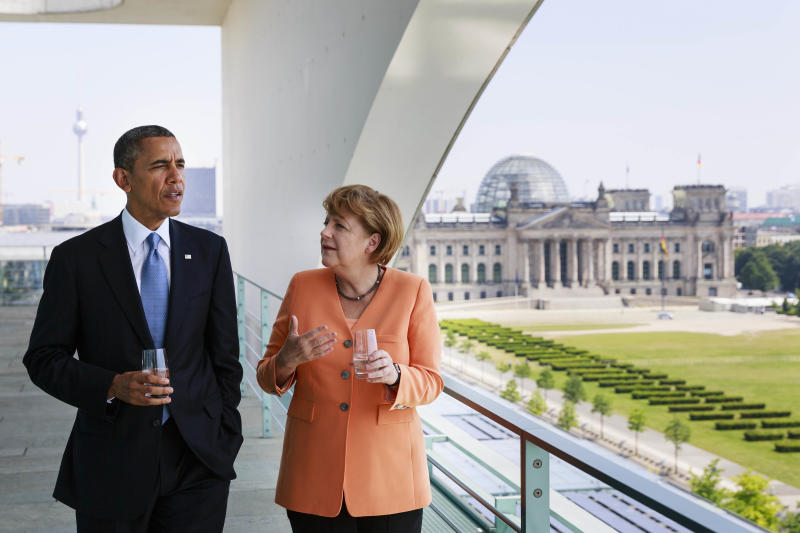 In this picture publicly provided by the German Government's Press Office, German chancellor Angela Merkel, right, talks to US President Barack Obama at the chancellery in Berlin, Wednesday June 19, 2013. At right in background the German Parliament's building, the Reichstag. On the second day of his visit to Germany, Obama met with German President Joachim Gauck and Chancellor Angela Merkel before delivering a speech at Brandenburg Gate. (AP Photo/Steffen Kugler, Bundesregierung)