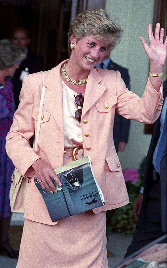 <p>The mother-of-two paired a salmon skirt suit with gold jewellery to Wimbledon. </p>