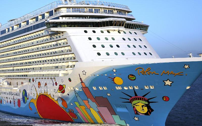 In this April 29, 2013 photo provided by Norwegian Cruise Line, the Breakaway, a new ship from Norwegian Cruise Line, sports a colorful mural of the city New York City skyline by pop artist Peter Max as it sails out of Southampton, England, headed to New York. The New York City-themed ship, which will homeport from New York, is scheduled to be christened in New York Wednesday May 8, 2013. (AP Photo/Norwegian Cruise Line)