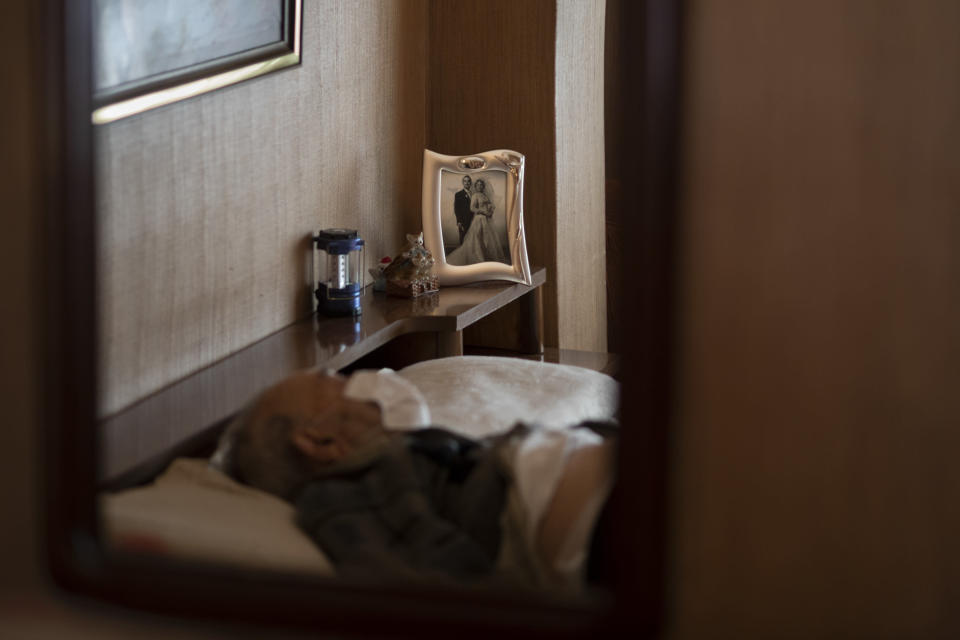 Leopoldo Roman, 85, lies in bed wearing a face mask as he waits for doctors during a home medical visit in Barcelona, Spain, April 3, 2020. Roman, whose leg was amputated years ago, has to pay for daily care out of his pension since the public system only provides for a social worker to come for an hour a day, three days a week. The image was part of a series by Associated Press photographer Emilio Morenatti that won the 2021 Pulitzer Prize for feature photography. (AP Photo/Emilio Morenatti)
