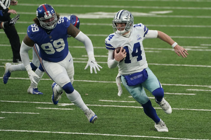 Dallas Cowboys quarterback Andy Dalton, right, tries to evade the New York Giants defense during the second half of an NFL football game, Sunday, Jan. 3, 2021, in East Rutherford, N.J. (AP Photo/Corey Sipkin)