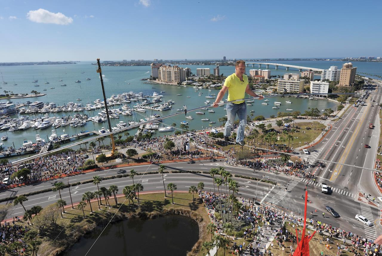 Nik Wallenda walks across a tightrope 200 feet above U.S. 41 on January 29, 2013 in Sarasota, Florida.  (Photo by Tim Boyles/Getty Images)