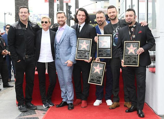 Carson Daly and Ellen DeGeneres congratulate the members of NSync as the band is honored with a star on the Hollywood Walk of Fame. (Photo: Steve Granitz/WireImage)