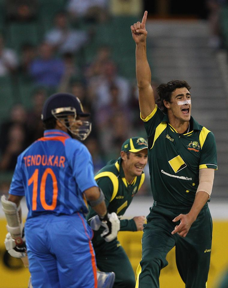 Mitchell Starc celebrates the wicket of Sachin Tendulkar during game one of the Commonwealth Bank tri-series between Australia and India at the Melbourne Cricket Ground on   February 5, 2012 in Melbourne, Australia.