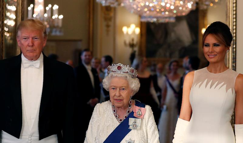 U.S. President Donald Trump, First Lady Melania Trump and Britain's Queen Elizabeth pose at the State Banquet at Buckingham Palace in London, Britain June 3, 2019. Alastair Grant/Pool via REUTERS