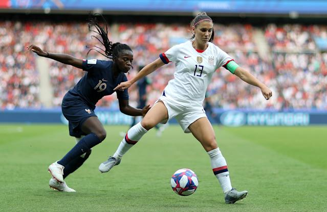 Alex Morgan of the USA battles for possession with Griedge Mbock Bathy of France during the 2019 FIFA Women's World Cup France Quarter Final match between France and USA at Parc des Princes on June 28, 2019 in Paris, France. (Photo by Naomi Baker - FIFA/FIFA via Getty Images)