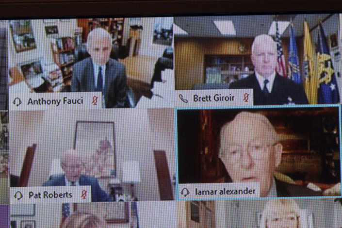 Chairman Lamar Alexander, R-Tenn., shown on a monitor, right, speaks during virtual Senate Committee for Health, Education, Labor, and Pensions hearing, Tuesday, May 12, 2020 on Capitol Hill in Washington. Dr. Anthony Fauci, director of the National Institute of Allergy and Infectious Diseases, top left, is to testify before the committee. (Win McNamee/Pool via AP)