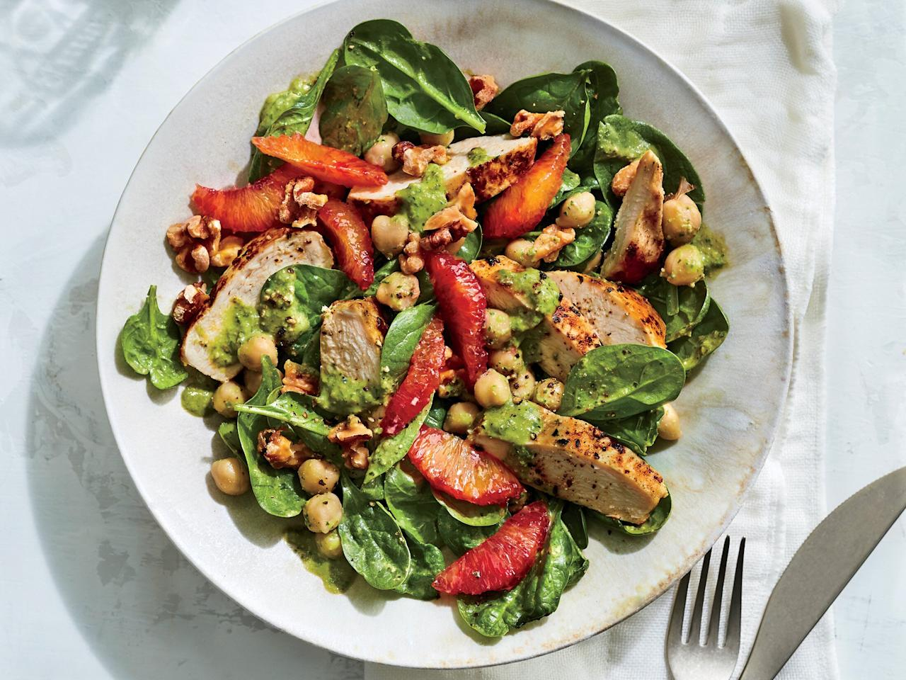 """<p>Starting with pre-cooked leftover chicken, this recipe comes together in only 10 minutes. Thanks to a variety of ingredients, this salad is a nutritional powerhouse, brimming with antioxidants from the oranges, heart-healthy fats from the walnuts and avocado, and folate and vitamin A from the spinach. We skip the croutons and add toasted walnuts for some heart-healthy crunch.</p> <p><a href=""""https://www.myrecipes.com/recipe/chickpea-spinach-salad"""">Chickpea Spinach Salad Recipe</a></p>"""