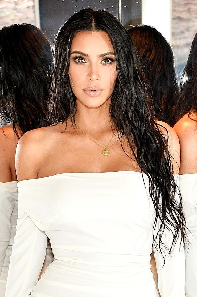 <p>West seems to love wavy hair, and she wore her hair styled as such for The Launch Of KKW Beauty. (Photo: Stefanie Keenan/Getty Images for Full Picture) </p>