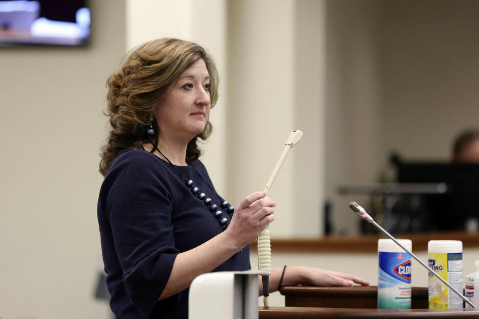 "Melissa Anne ""Mac"" Cunningham-Sereque shows the wand used to do ultrasound on pregnant women during a South Carolina House subcommittee hearing on an abortion bill on Wednesday, Feb. 3, 2021, in Columbia, S.C. The bill would outlaw almost all abortions in the state. (AP Photo/Jeffrey Collins)"